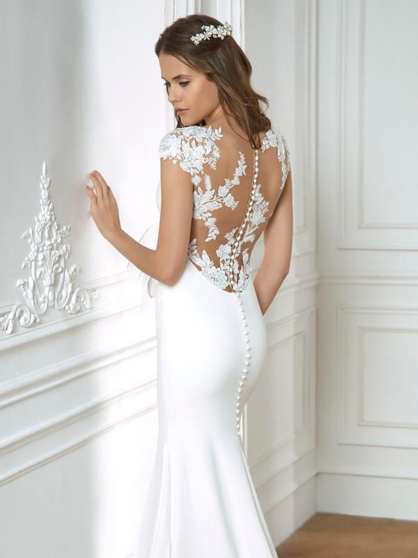 Espalda con efecto tatuaje del vestido de novia.